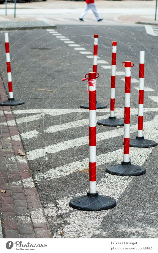 White and red traffic cones bunch risk boundary accident security caution pavement industrial pedestrians outdoors urban closeup warning street safety road