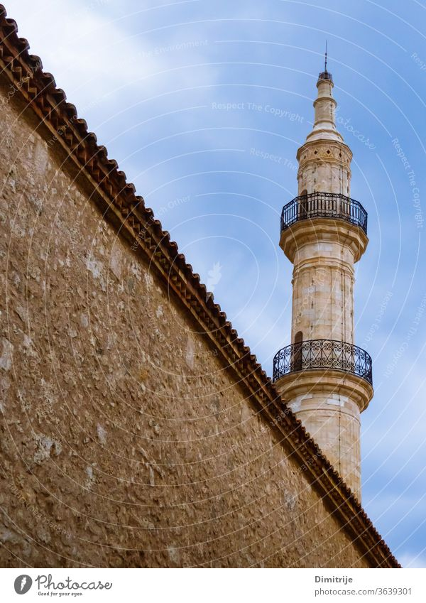 Mosque tower with big wall in front of it mosque travel tourism architecture building landmark sky town religion minaret old history city islam europe medieval