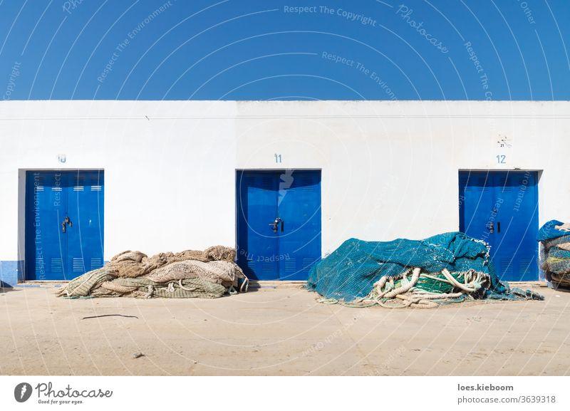 Port storage building with blue doors and fishing nets, Altea, Costa Blanca, Spain Net Harbour Ocean Nature Water Fishing industry Blue travel Fisherman Europe