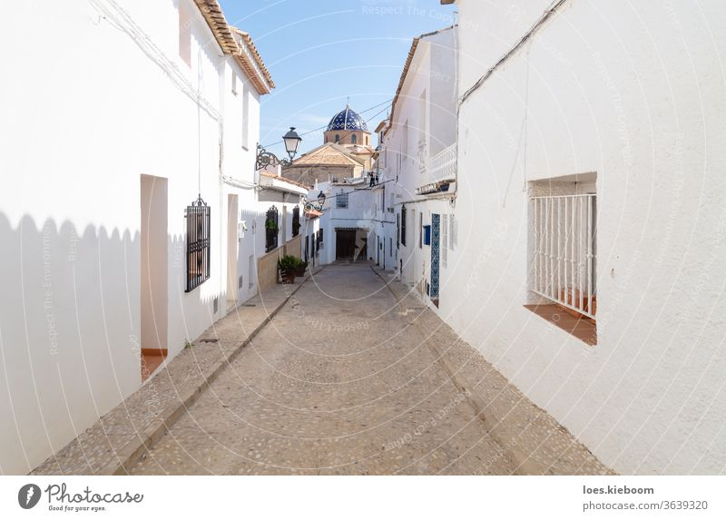 Narrow medieval road to the blue domed church in the old town of Altea, Costa Blanca, Spain Alley travel Street Town Church Mediterranean Destination Dome