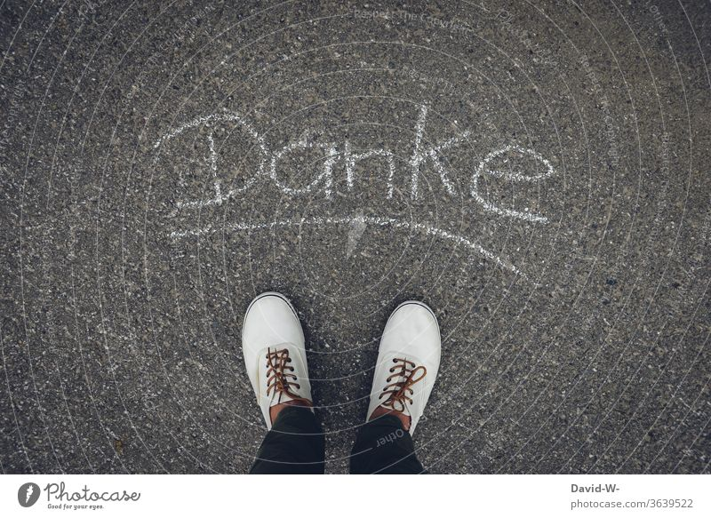 Man says thanks Thank you. I'll take care of it. Word Chalk foot Footwear Street Asphalt Letters (alphabet) Stand Exterior shot Grateful Thank you very much