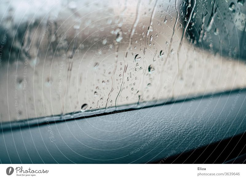View from the car window in the rain Car Window Rain raindrops Window pane Bad weather Vehicle Wet Autumn Motoring Weather Drops of water Detail