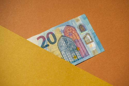20 Euro note. Bank note. Money. 20 euros pretence half Concealed Copy Space graphically Financial Industry Save Loose change Individual Blue Yellow Orange Beige