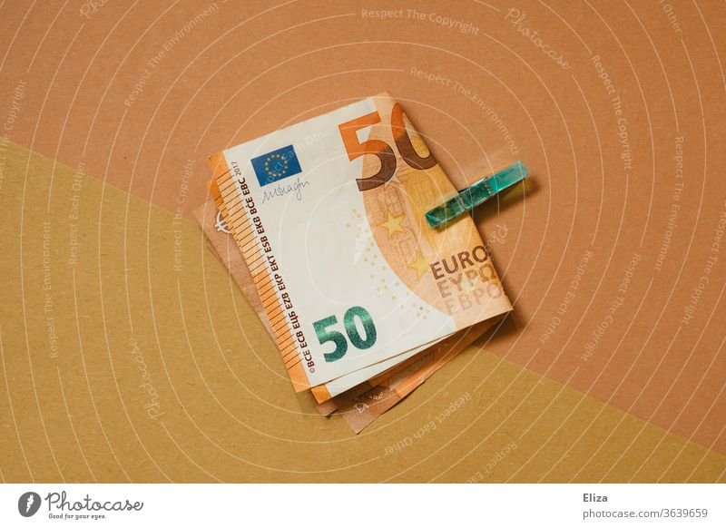 Two 50 Euro notes held by a clamp. Tone in tone. Money Notes 50s 50 euros Holder tone-in-tone Esthetic Financial Industry Bank note Save Loose change
