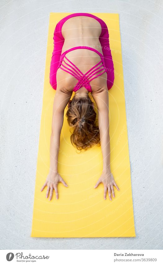 stretching back.photo of the girl doing yoga by the gym mat woman young pose lifestyle fitness concentration female health exercise workout training people