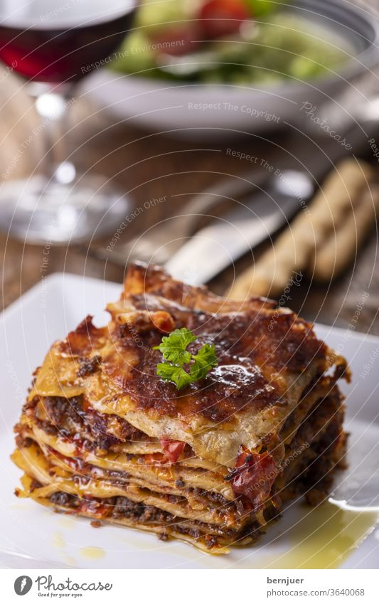 Lasagne on a plate Plate Delicious Minced meat dressed Carbohydrate pasta bake pile Italy European Bolognaise Rustic Tasty ingredient stratified bechamel