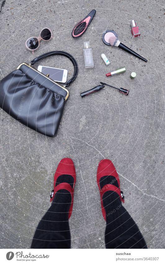 fallen down handbag of a lady with fallen out utensils Woman Lady feminine Feminine Legs High heels foot red shoes Asphalt Street Handbag Sunglasses Hairbrush