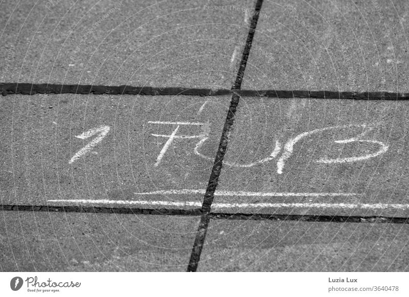 Chalk writing on the sidewalk, 1 foot and further hopscotch Chalk drawing Sidewalk Children's game Town urban Black & white photo lines Playing Exterior shot