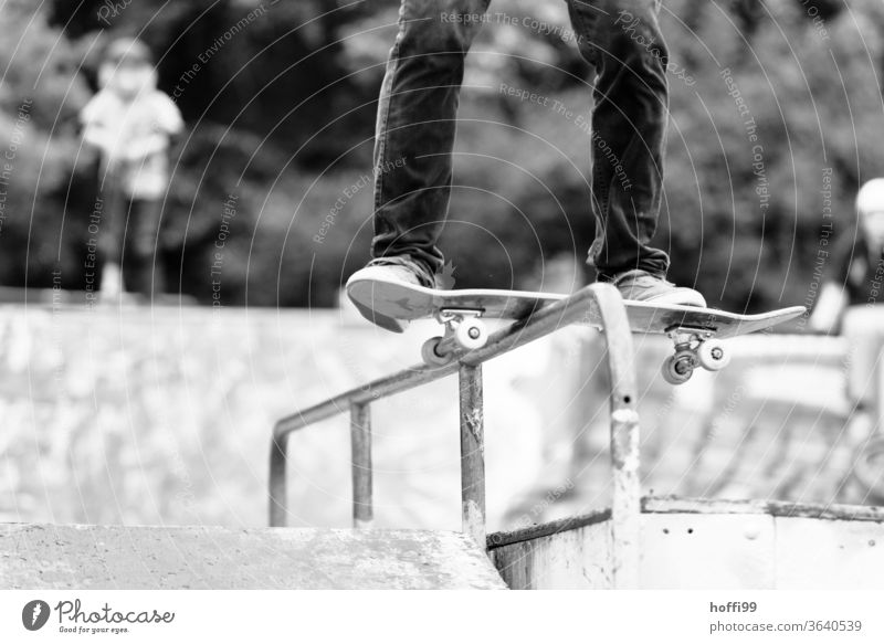 Skateboard slides over a railing Skateboarding Funsport Jump Trick Trick jump Youth (Young adults) Sports Action Lifestyle Shadow Coil street Light Stunt