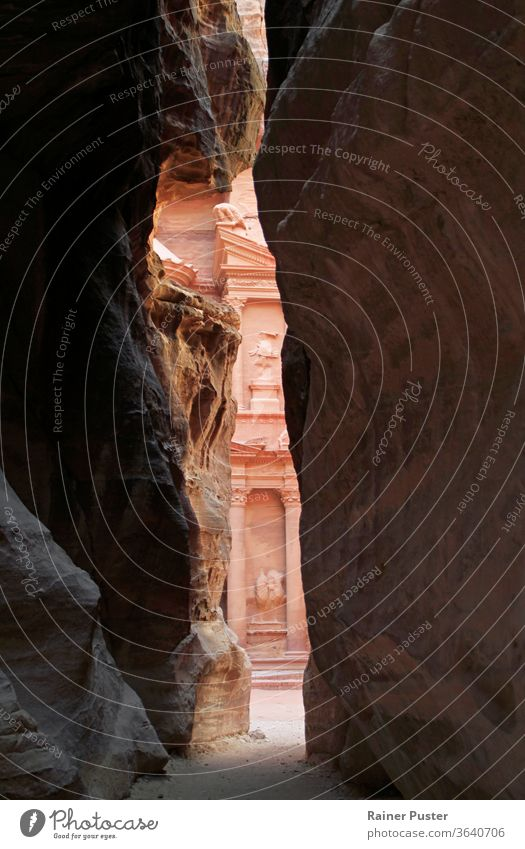 A glimpse of the treasury in Petra, Jordan adventure ancient antique arab arabian arabic archeology architecture building canyon carved civilization culture