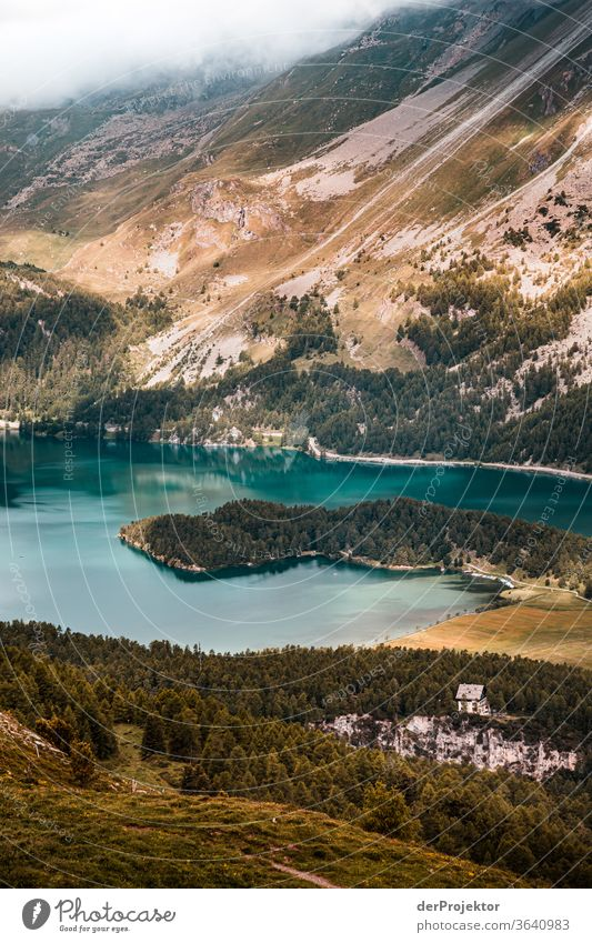 View from Piz Corvatsch in the Engadin in Graubünden in Switzerland to the Silsersee Sunbeam Day Light Exterior shot Alps Nature Nature reserve Effort
