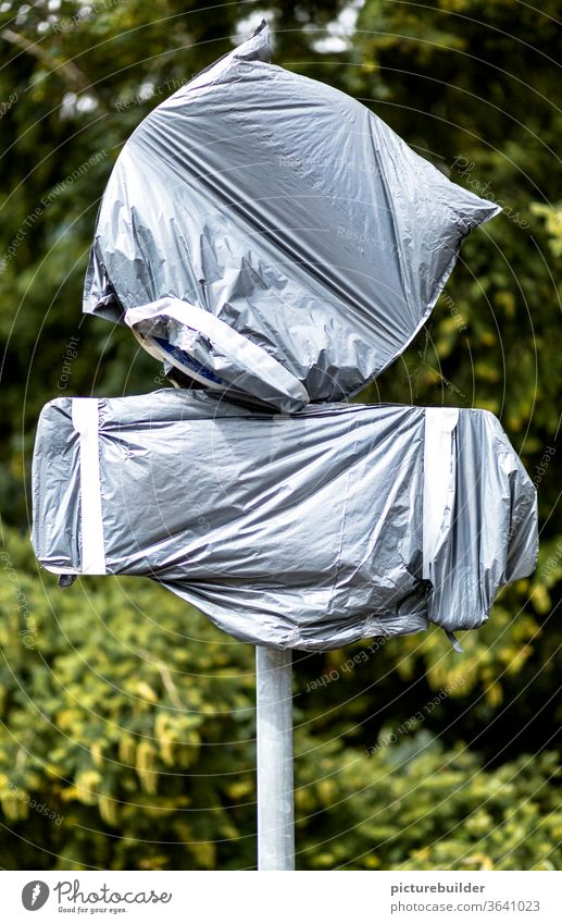 Packed road signs tarpaulin Signs Signs and labeling stake Packaged shrouded Round Rectangle Adhesive tape Invisible Gray green Day Deserted Exterior shot