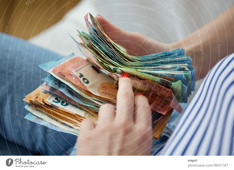 Traveller's cash box | Young woman holds a stack of banknotes in her hands and counts through. Money Bank note Euro Loose change figures Save Income Luxury