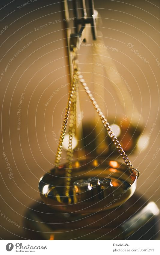 Brass balance with weights oscillates until it displays the result Scale Time Money concept Balance Weight Fairness Honest Justice judiciary Lady Justice Detail