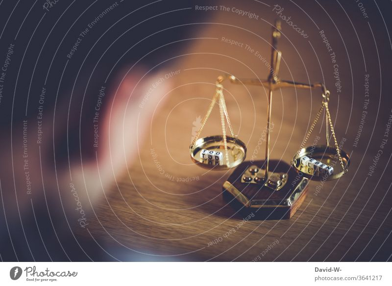 in waage - death and life / death penalty Scale Time Death Life concept Death penalty Balance Weight Fairness Honest Fate Future Justice judiciary Lady Justice
