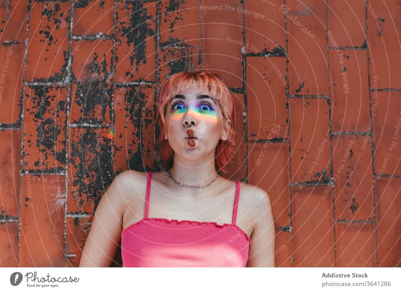 Happy woman making fish mouth millennial pink hair make face carefree rainbow behavior expressive female grimace different creative modern happy trendy street