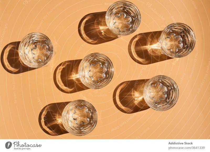 Various glassware on orange table assorted bottle shiny ripe grape fruit composition fresh organic beverage arrangement natural delicious vitamin sweet