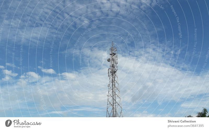 Telecommunication tower on blue sky and white fluffy clouds abstract background. Copy space nature and environment concepts. Antenna Broadcasting tower