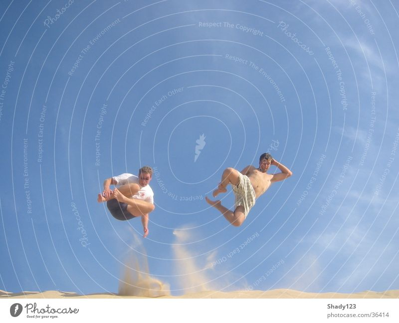 together on the sand Vacation & Travel Jump Beach Sand Sky Blue