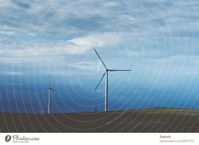 Wind turbine in the field, toned photo. Wind power energy concept wind generator industry electricity alternative landscape clean nature renewable environment
