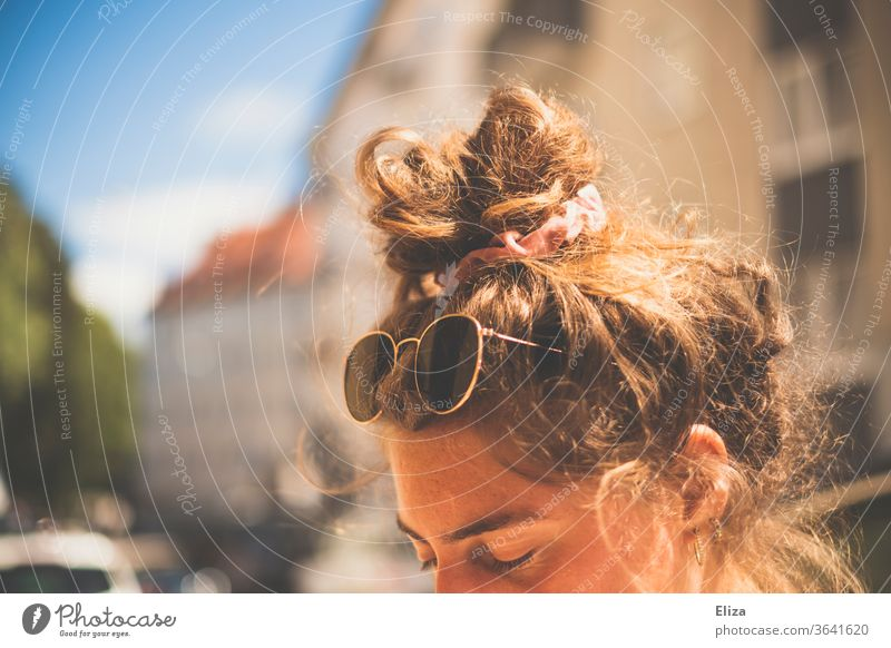 A young woman with sunglasses and bun in her hair in the sun Chignon Sunglasses Summer sunny Summery sunshine Vacation mood hairstyle pinned up Knot Topknot