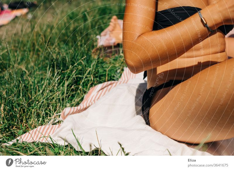 Young woman in bikini on a blanket in the meadow in the sunshine. sunbathe Bikini bathing weather Woman Summer Nature Meadow Blanket Sit Relaxation Sun Summery