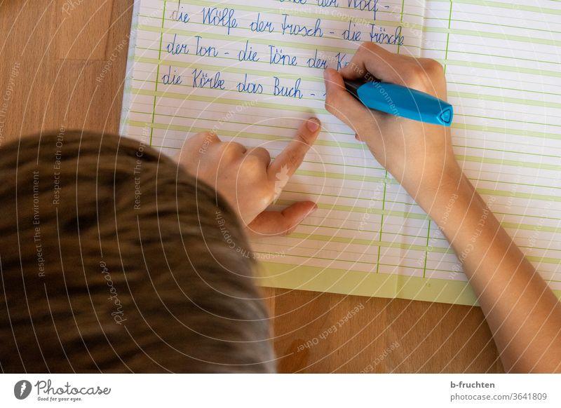 Child writes in the German booklet. Home exercises, school exercises Booklet Write Feather fountain pen Education Pen Homework Infancy Paper schuler Schoolchild