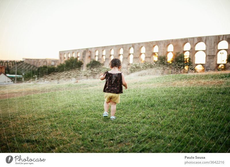 Child playing with water sprinklers Water Summer Summer vacation Garden Park outdoors Refreshment refreshing Day Joy Exterior shot Lawn Rain Drops of water