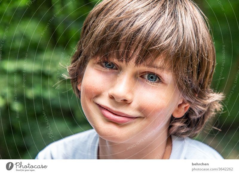 I'm done smiling now? cheerful Happiness Close-up Sunlight Face Happy Child Boy (child) portrait Light Detail Trust Colour photo Day Son Together Love