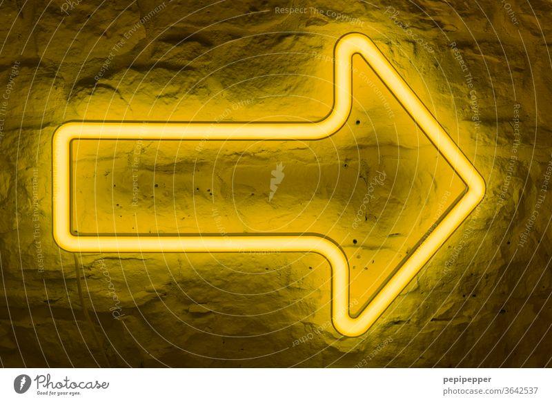 that way, please - yellow neon arrow on stone wall Arrow Neon light Light Lamp Bright Lighting Illuminate Radiation Colour Neon sign Billboard Yellow
