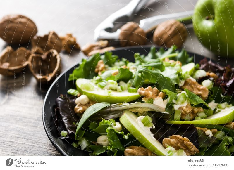 Fresh Waldorf salad on wooden table. Copy space american apple autumn celery cheese delicious diet diner food fresh fruit green healthy lettuce mayonnaise