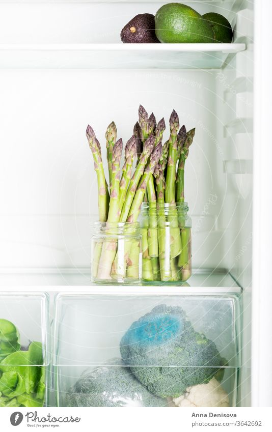 Flavoursome, sweet and tender British asparagus in the fridge fresh green white raw natural british season avocado salad detox diet bunch food spring healthy