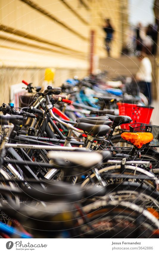 Row of bicycles parked outside a building Munich accessory aluminum assembly background bell bike biking blur chain closeup component equipment gear germany