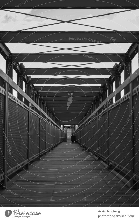 Black and white empty walkway with symmetry abstract architecture background beautiful black boardwalk bridge building city concept construction design