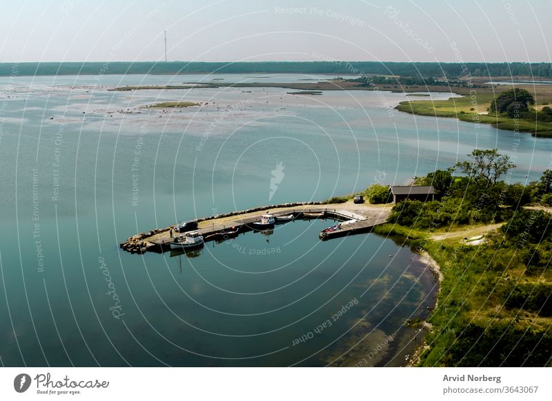 View from a lighthouse over a jetty at Öland, Sweden background beautiful black boat boats car coast dock floating green island jump lake landscape marina