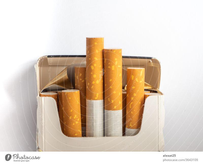 Cigarettes pack on white background addict addiction bad habit bunch cancer cigarette cotton damage danger death drug filter group health healthy illness lung