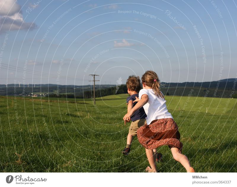 Human being Child Sky Summer Girl Joy Meadow Movement Grass Playing Boy (child) Dream Friendship Leisure and hobbies Infancy Power