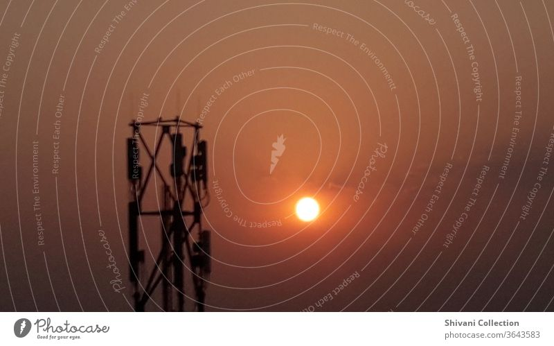 Telecommunication tower with sunrise moments with colourful sky background. Copy space nature and environment concepts. Antenna Beautiful scenery broadcast