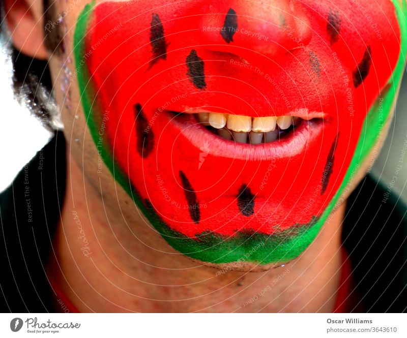Watermelon face man. watermelon colors men male adult people smiling happy