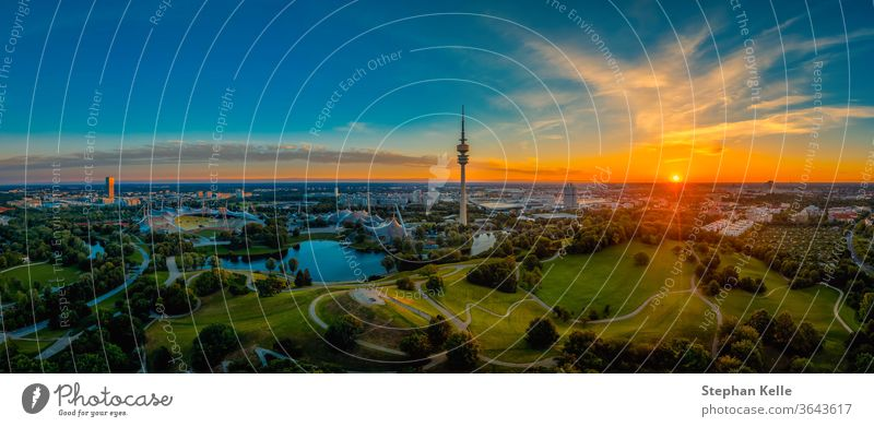 Eyecatching sunrise view over Munich at a wonderful morning at a summer day as panorama. Muenchen park aerial atmosphere authentic image photo green total