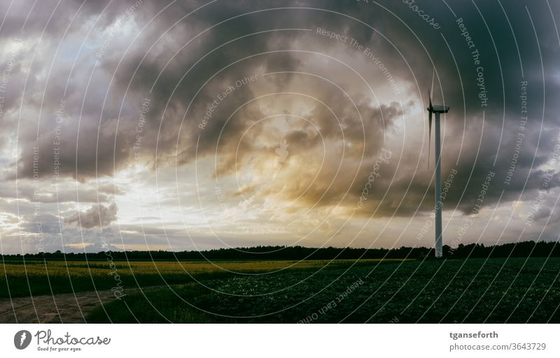 Sunset in front of wind turbine Wind energy plant wind power Wind power station Clouds Clouds in the sky Cloud formation Cloud cover cloud landscape
