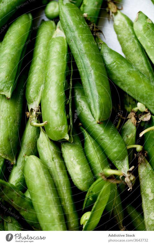 Top view macro image of sweet peas green vegetable organic food produce harvest vegan diet ingredient healthy nutrition pod spring vitamin legume cooking