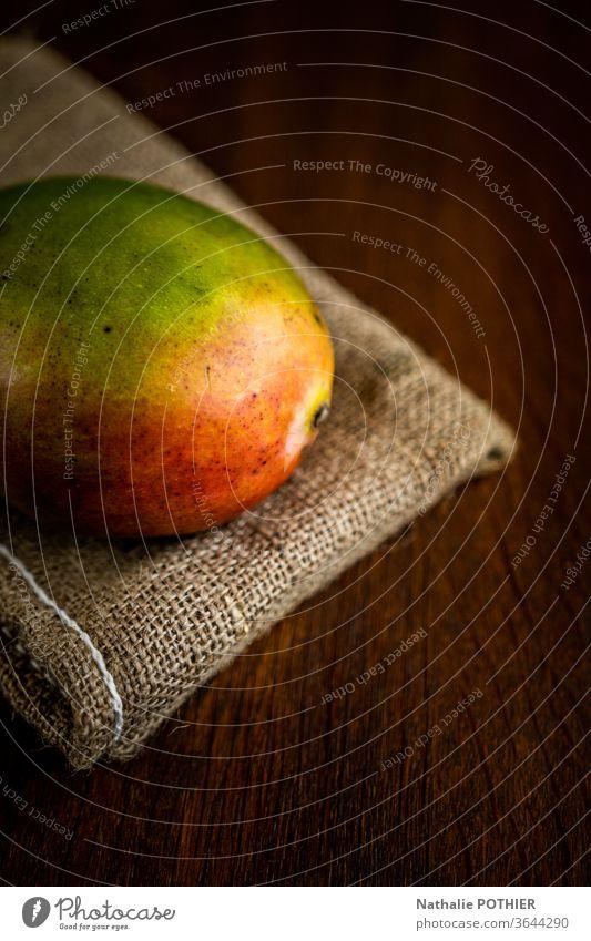 Mango on burlap mango mango fruit Colour photo Wooden table Light Fruit Tropical fruits juce jucy juicy fruits Food Healthy Eating Fresh Nutrition
