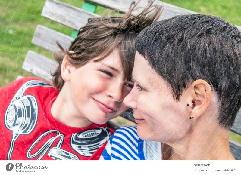 conform | same feelings Contrast Sunlight blurriness portrait Light Day Close-up Exterior shot Colour photo Motherly love Happy Happiness Contentment Trust