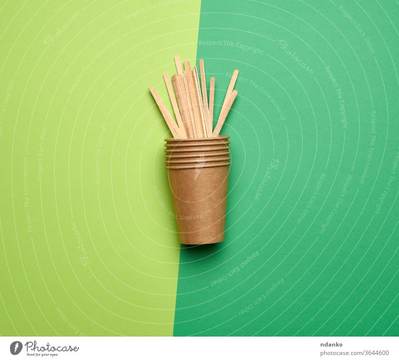 disposable empty cups of brown craft paper and wooden sticks dishware drink fast flat background beverage blank cardboard closeup coffee color conceptual