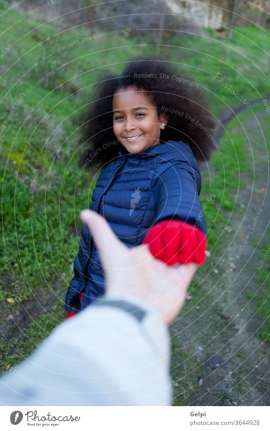 African little girl shakig hands with somebody person afro hair long brunette aid care people african family shake hands guide portrait happy american child