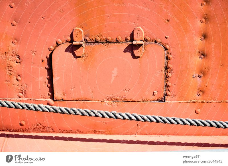 Cat flap on board | flap in the steel side of a ship boat detail Flap Ship's side Auburn Old Steel Stud hand-riveted Colour photo Exterior shot Navigation