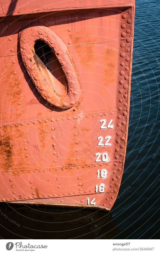 Bow and draught indicator Draft Watercraft Navigation Harbour Ocean Exterior shot Colour photo Deserted Day Detail Auburn boat Old metal sheet rivets Riveted