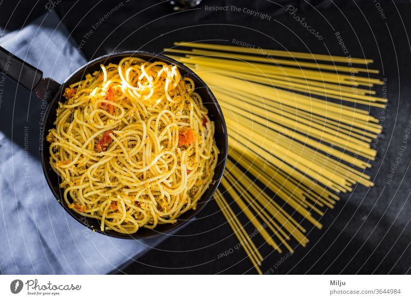 Cooked Spaghetti With Fried Eggs in fry pan pasta spaghetti food italian meal plate cuisine dinner noodles cooking dish healthy isolated macaroni ingredient