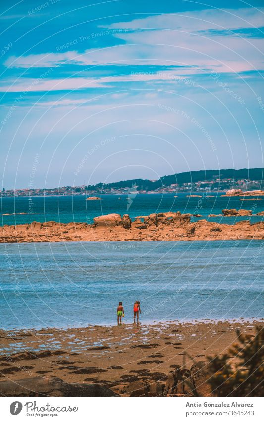 children on beach looking at the sea in galicia (spain) horizon Lifestyle childhood fun play sun ocean summer smiling sand tourism nature lifestyle joy holidays